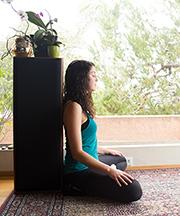 Sitting cross legged against wall