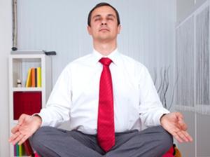 Man meditating on desk